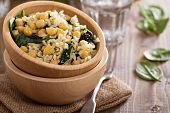Salad with rice, chickpeas, spinach, raisins