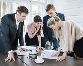 Young business people brainstorming at conference table in office