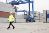 Full-length of female worker walking in shipping yard
