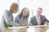 Businesspeople in meeting room