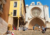 Tourists Near The Entrance To The Cathedral Of Tarragona