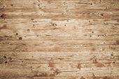 stock photo of uncolored  - Background texture of natural brown uncolored wooden wall - JPG