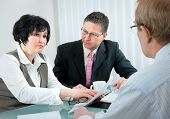stock photo of lawyer  - woman and her lawyer in conversation with husband during divorce process - JPG