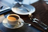 Fresh coffee in white cup served for breakfast