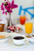 Fresh coffee, orange juice and granola served for breakfast