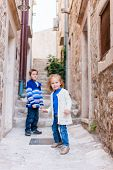 Brother and sister at narrow street in Dubrovnik Croatia