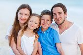 Happy beautiful family with kids on a tropical beach vacation