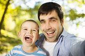 image of father time  - Father and son spending time together in sunny nature - JPG