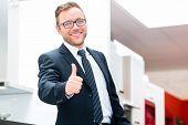 Salesman for domestic kitchen in studio or furniture store