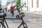 Old Cd's Or Dvd's Used As Bycicle Reflectors In Cuba