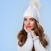 Winter. Cute girl on a blue background