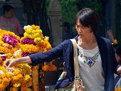 Woman Makes Offering At Erawan Hindu Shrine In  Bangkok.