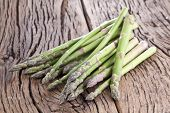 Bunch of asparagus on a wooden table.