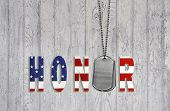 stock photo of tribute  - Star and stripe pattern honor with military dog tags on weathered wood background - JPG