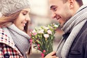 foto of fall day  - A picture of a man giving flowers to his lover on a winter day - JPG