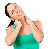 young brunette woman with a pain in the neck isolated on a white background