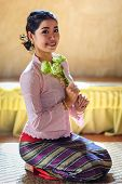 Thai Girl Hold Lotus Flower Sit In Temple