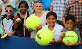 Young tennis fans waiting for autographs at Billie Jean King National Tennis Center
