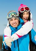 Portrait of happy couple of skiers have fun. Concept of winter sports and cute vacations