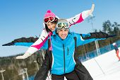 Half-length portrait of happy couple of alps skiers have fun. Concept of winter sports and cute vacations
