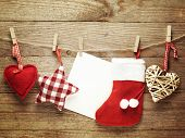 Festive Christmas decoration over wooden board background with blank paper card