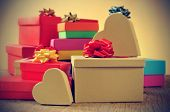 closeup of a pile of gifts in boxes of different colors, with a retro effect