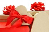 closeup of a pile of gifts in boxes of different colors on a white background