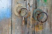 Old Wooden Door with Escutcheons and Padlocks