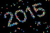 2015 written with colorful paper dots.