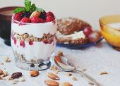 Granola With Cream And Fresh Berries And Cup Of Coffee, Typical Healthy Breakfast