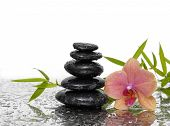 Spa wet Background with orchid with leaves and black stones
