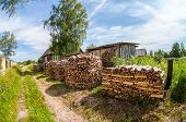Stack Of Firewood Stacked Near The Rural House