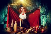 Attractive witch in the wizarding lair. Fairytales. Halloween.