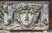 foto of medusa  - Part architrave with a frieze with mythical Gorgon Medusa head in ancient Temple of Apollo in Didim Turkey - JPG