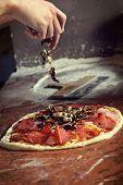 Fresh original Italian raw pizza, preparation in traditional style.