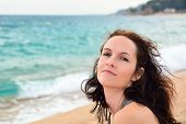 Cute woman posing on the beach