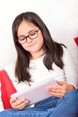 Schoolgirl learning with a Tablet PC at home