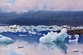 Icebergs and ice floes in the blue Ice lagoon Jokulsarlon. South-east Iceland in July