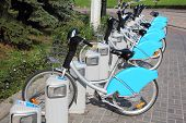 KAZAN, RUSSIA - AUGUST 03, 2013: Many bicycles in row on parking for rental