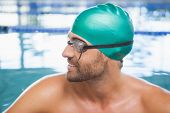 Close up of a fit swimmer in the pool at leisure center