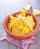 stock photo of chipotle  - corn chips in a bowl and sauce - JPG