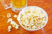 image of corn  - pop corn in white bowl and on a table - JPG