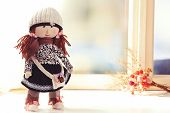 picture of rag-doll  - Handmade doll near window close - JPG