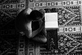 pic of quran  - Muslim Man Is Reading The Holy Quran - JPG