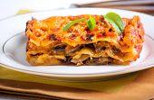 stock photo of lasagna  - Mushroom lasagna piece on plate selective focus - JPG