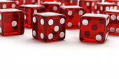 picture of dice  - Many red semi transparent dice with selective focus on white background - JPG