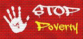 picture of poverty  - stop poverty give and donate to charity giving a helping hand graffiti on red brick wall - JPG