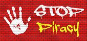 picture of illegal  - piracy stop illegal download of movies and music and illegal copying copyright and intellectual property protection protect copy of trademark brand graffiti on red brick wall - JPG