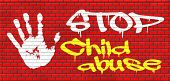 stock photo of neglect  - stop child abuse and neglection or violence toward children they need protaction against physical and psychological harassment graffiti on red brick wall - JPG
