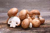 pic of champignons  - Brown champignon on wooden background in studio - JPG